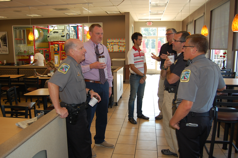 Deputies and Citizens in a coffee shop talking