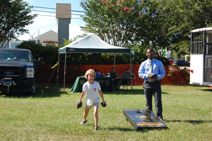 Deputy playing and outdoor game with children