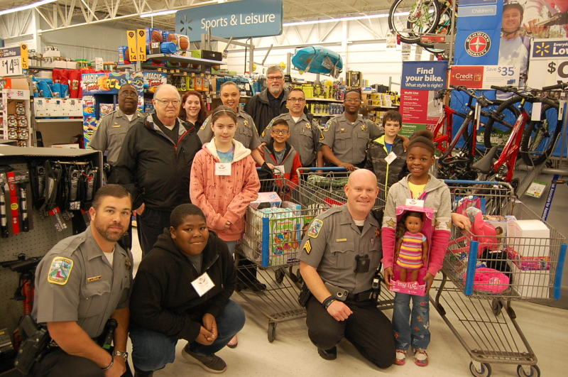 Deputies in a Toy store with children
