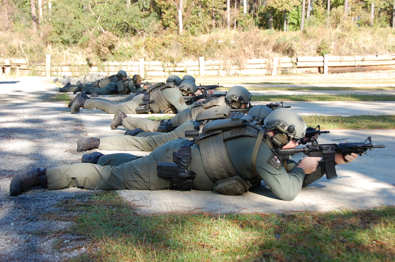Five officers using the shooting range