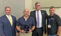 Sgt. Richard Branche, second from left, received the Trainer of the Year award from the S.C. Training Officer's Association Tuesday in Myrtle Beach. Assisting with the presentation were, from left, Neil Johnson, director of the Georgetown County Detention Center, Carter Weaver, Sheriff of Georgetown County, and Lt. Joshua Solomon of the York County Sheriff's Office, president of the association.