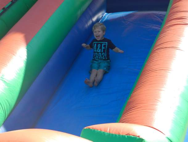 Child going down a water slide