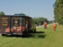 Inmates picking up litter on the highway