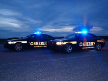 Two Sheriffs Office patrol Vehicle at night